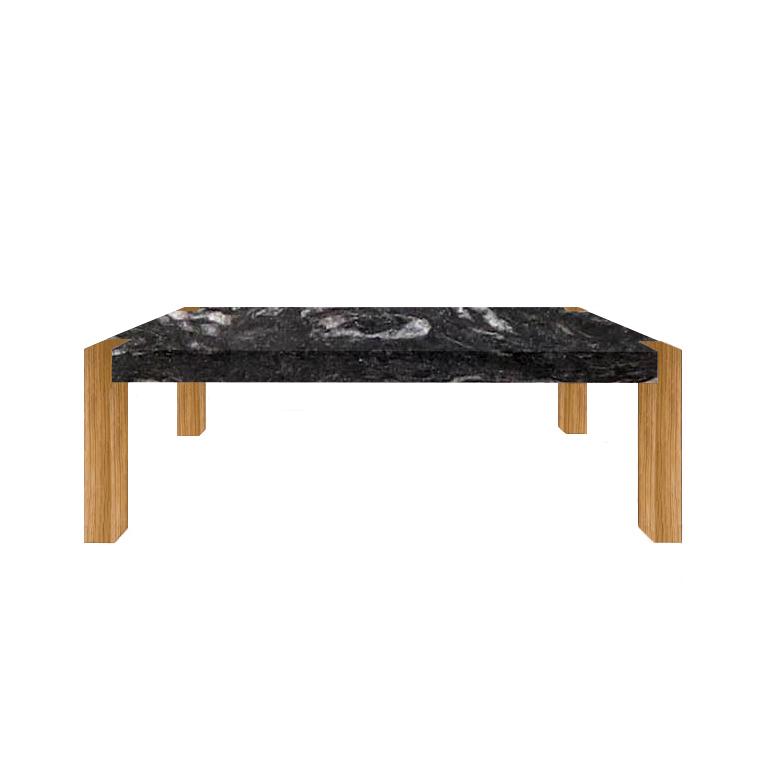 images/cosmic-black-dining-table-oak-legs.jpg